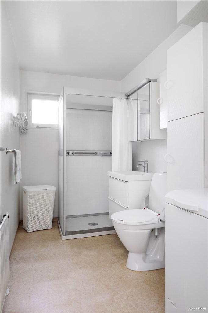 Badrum med egen tvättmaskin