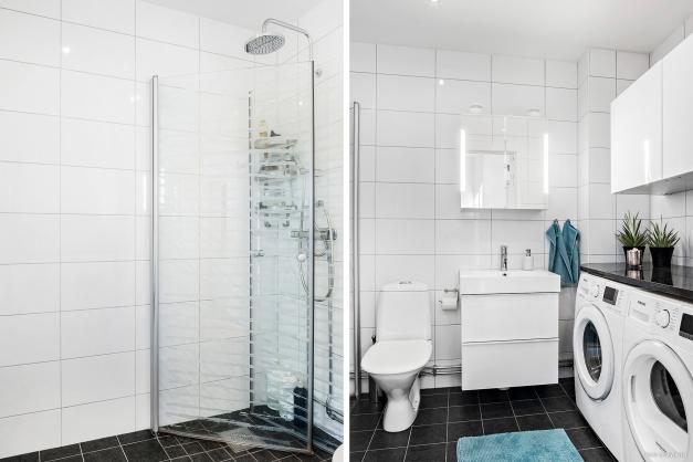 Stilfullt badrum med både tvättmaskin, torktumlare och bra förvaring