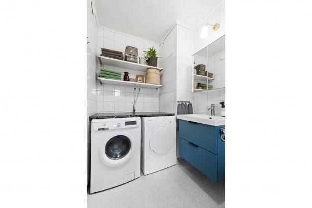 Duschrum med tvättutrymme
