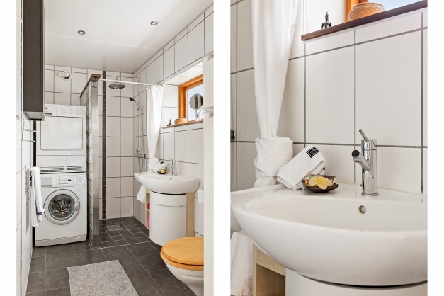 Helkaklat badrum med tvättpelare