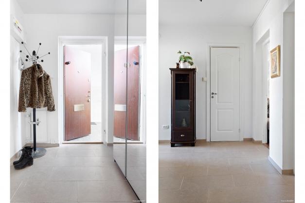 Hall med praktisk garderob och klinkergolv