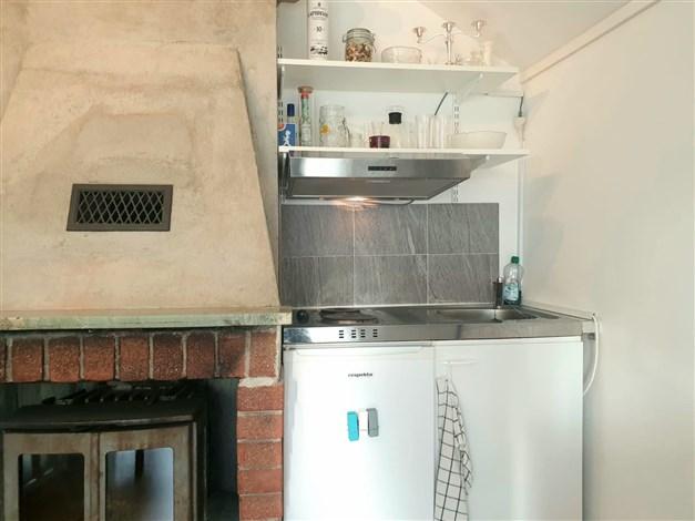 Braskamin och trinettkök i gästhus