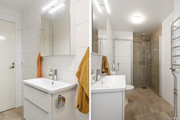 Fint renoverat badrum som är förberett för tvättmaskin