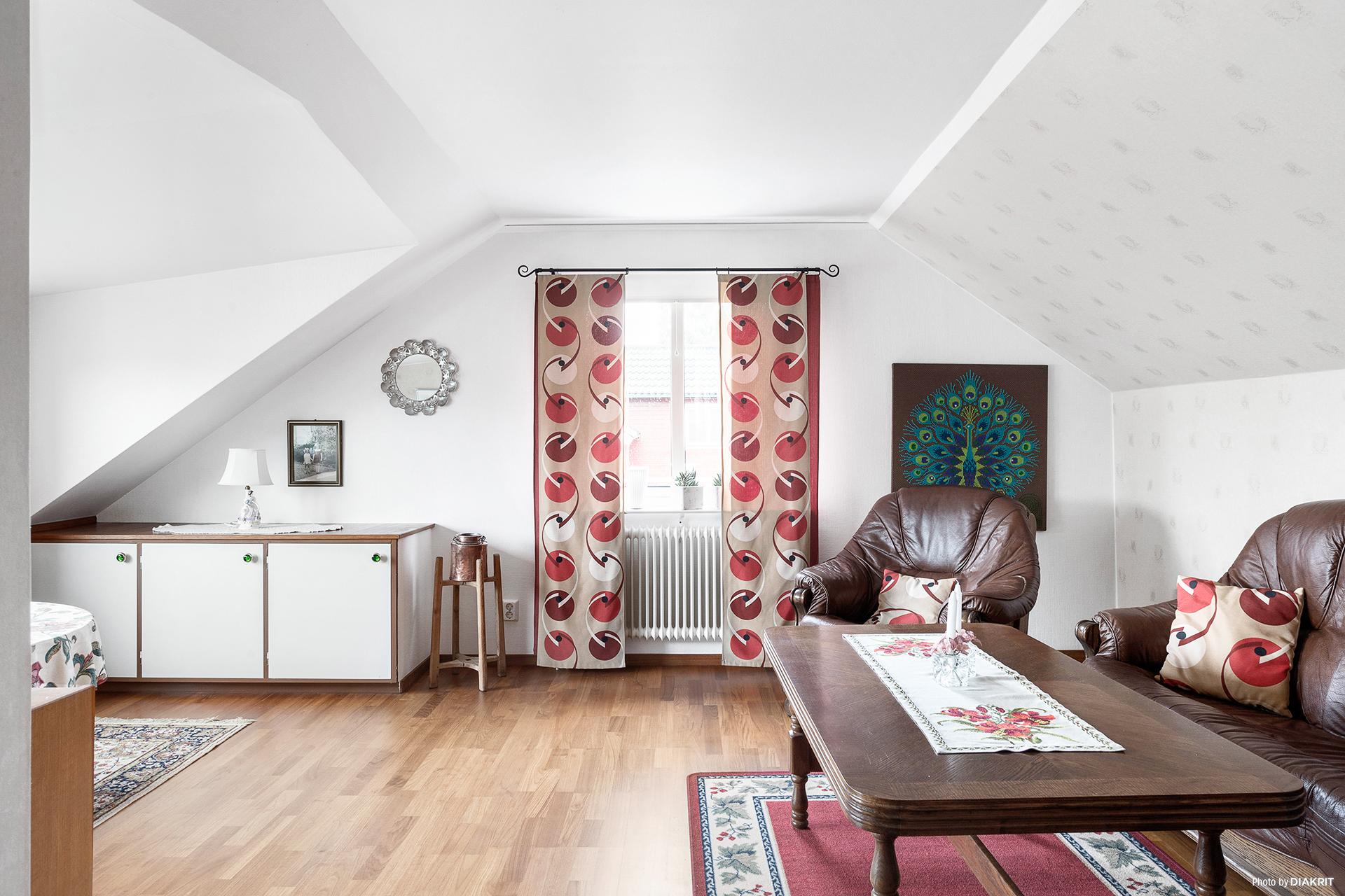 Sovrummet på med takkupa på det övreplanet