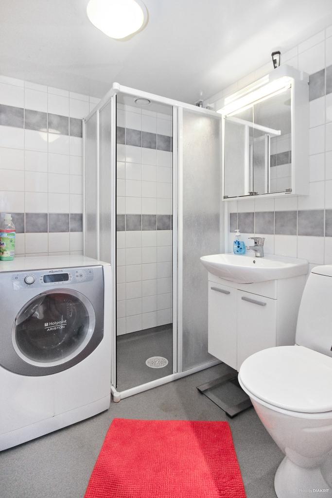 Toalett med dusch