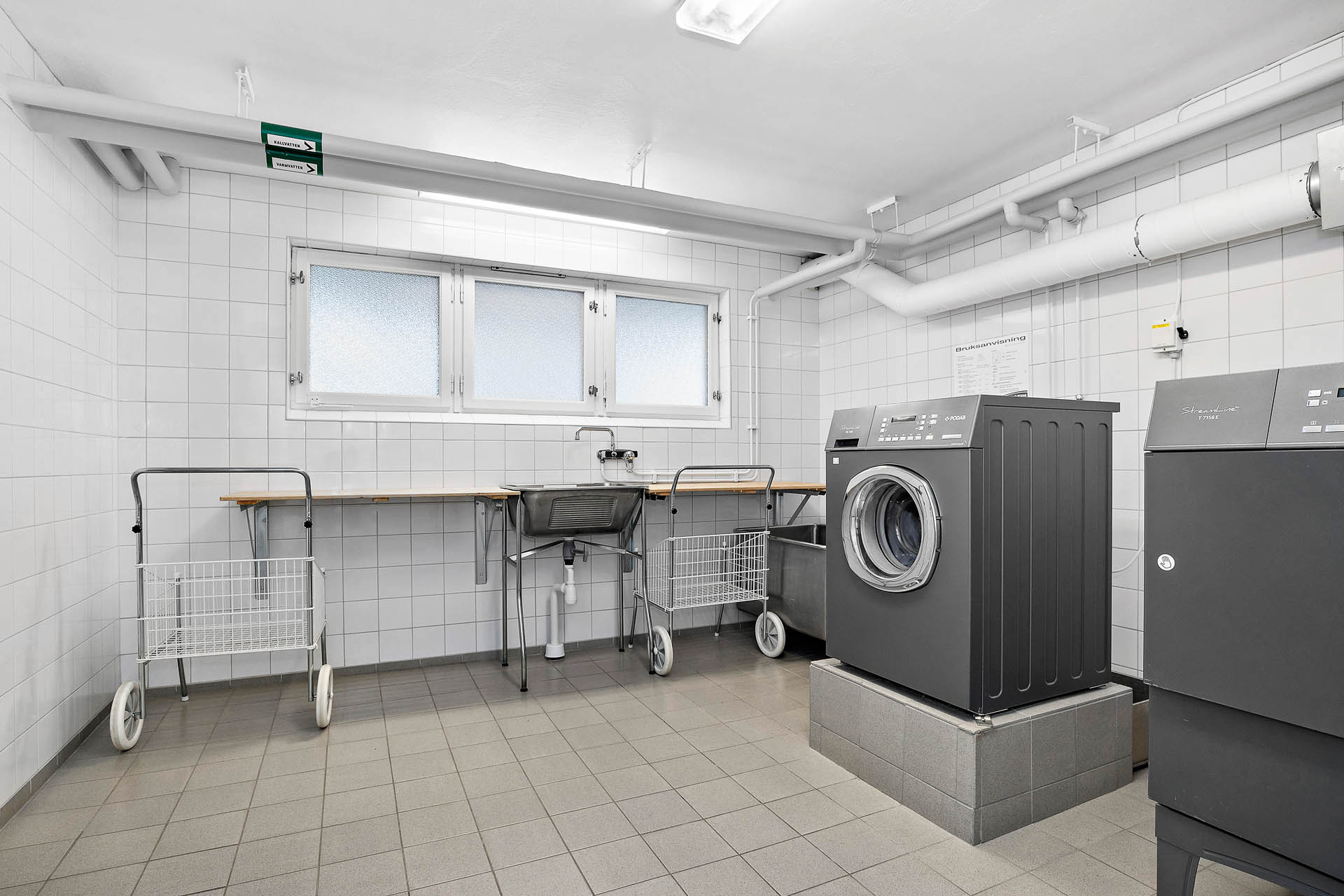 Gemensam tvättstuga i samma byggnad