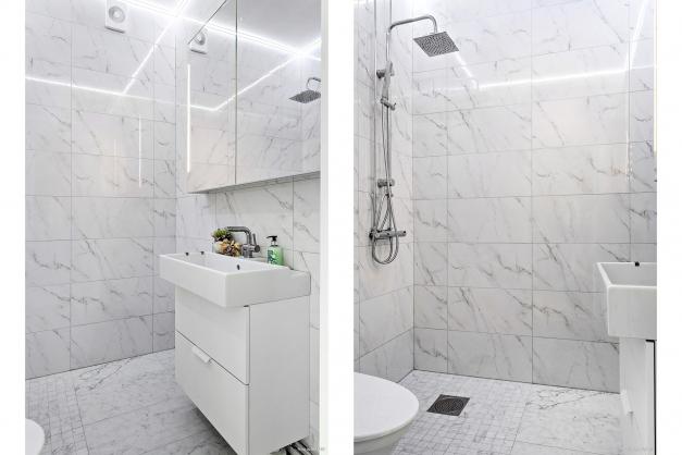 Splitternytt duschrum med stilrent marmorkakel