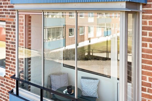 Inglasad balkong.