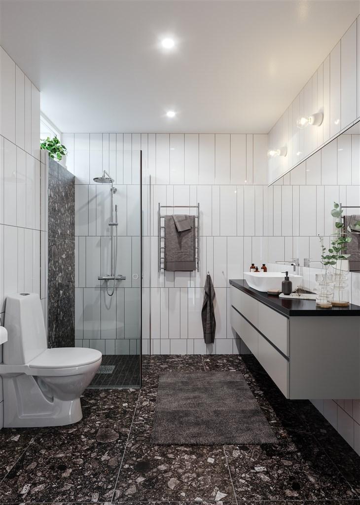 Val av designlinje går igenom även i badrummet, med inredning (kommod) från Ballingslöv.