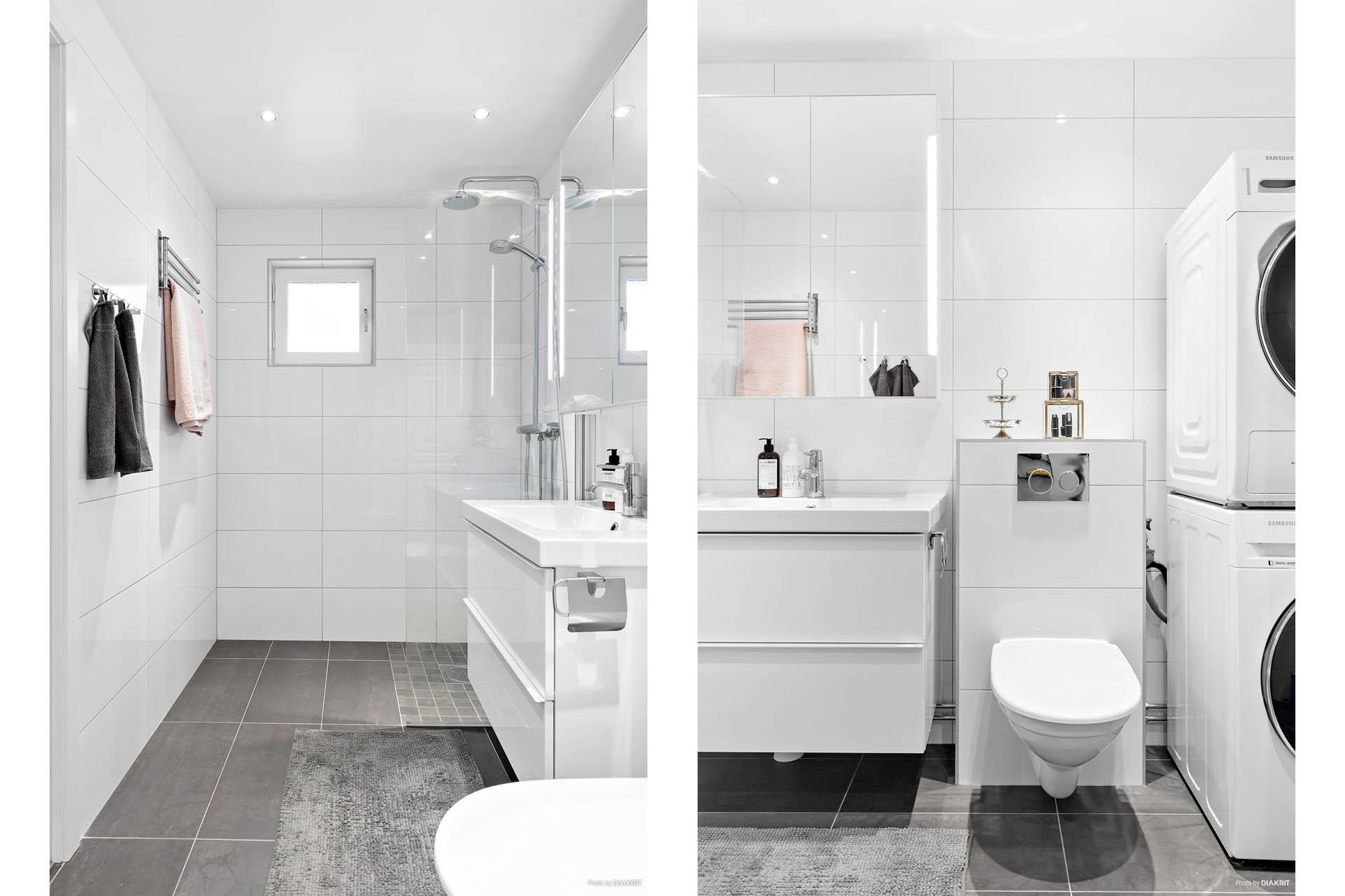 Stort helkaklat badrum med tvättpelare