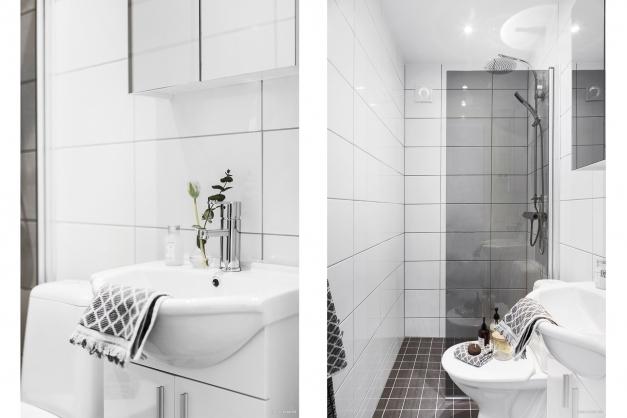 Helkaklat badrum med wc, handfat med kommod, spegelskåp.