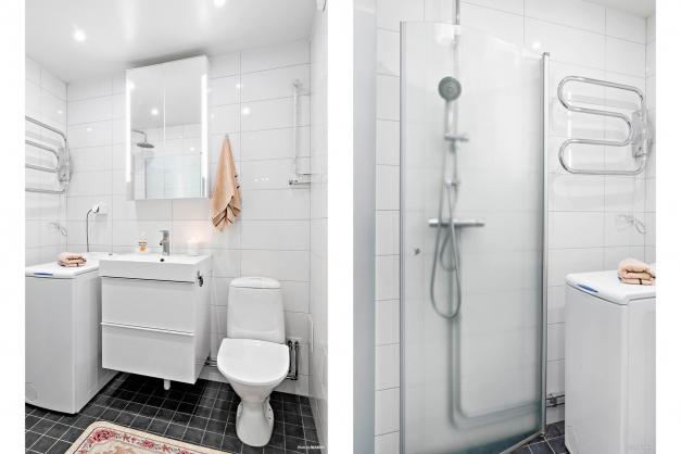 Helkaklat duschrum i stilrena kulörer samt handdukstork