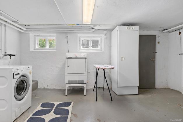 Gemensam tvättstuga i källarplanet