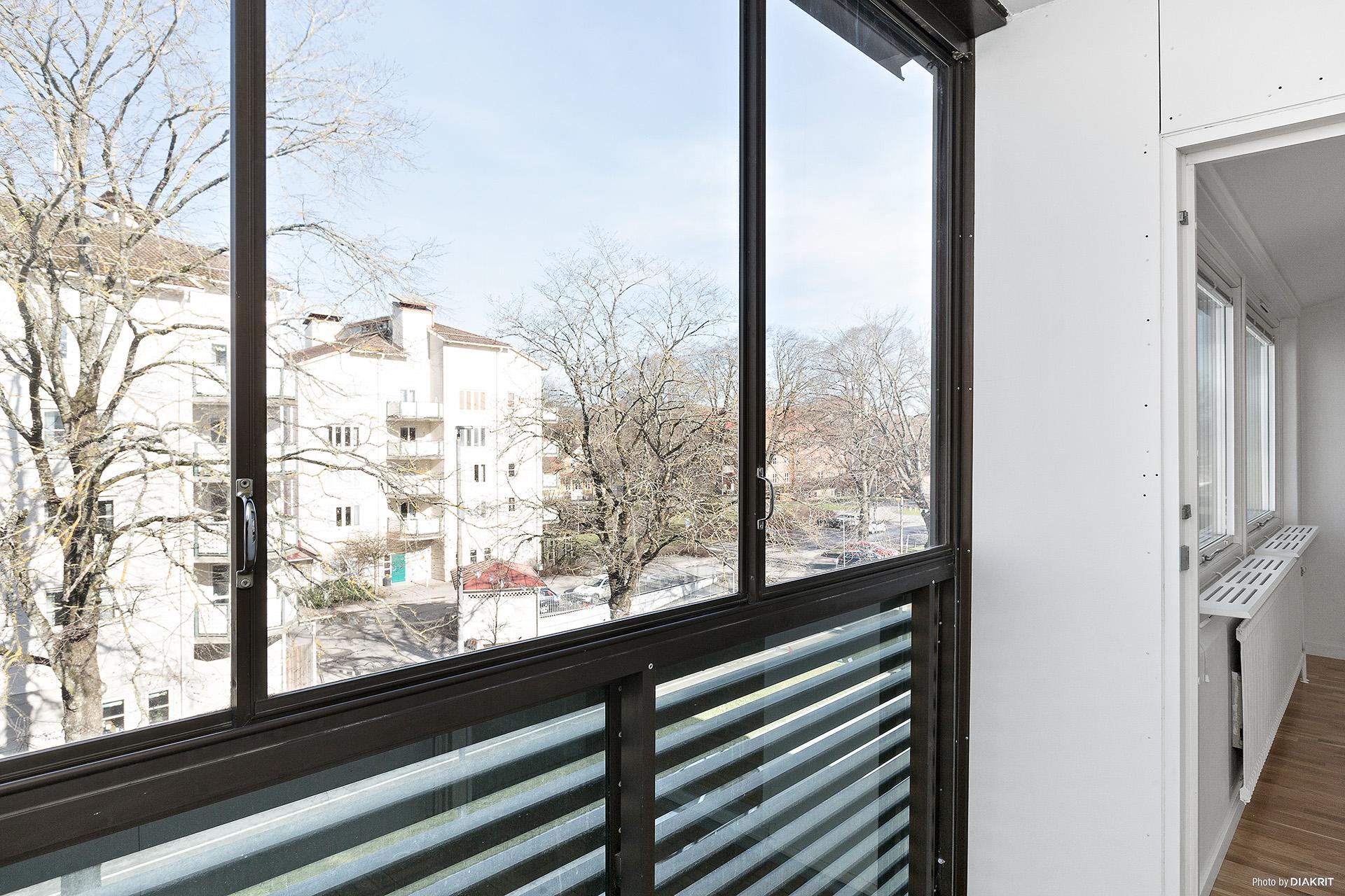Inglasad balkong med skjutpartier