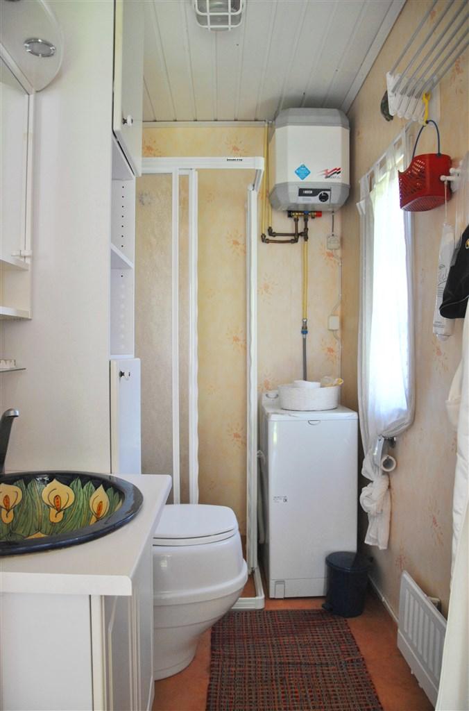 Duschrum med torrtoalett