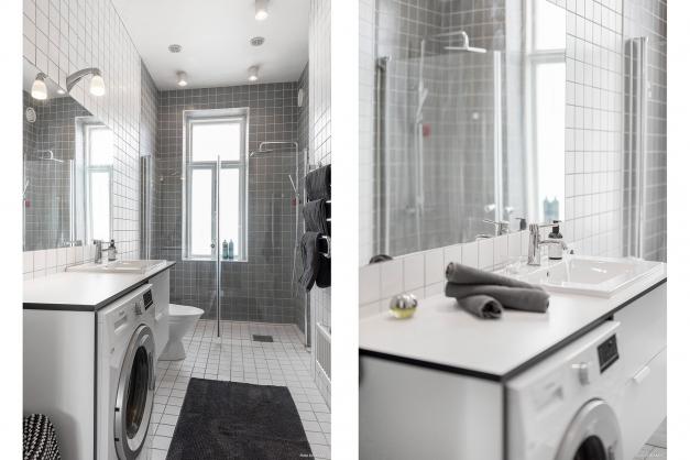 Helkaklat badrum med dusch och tvättmaskin.