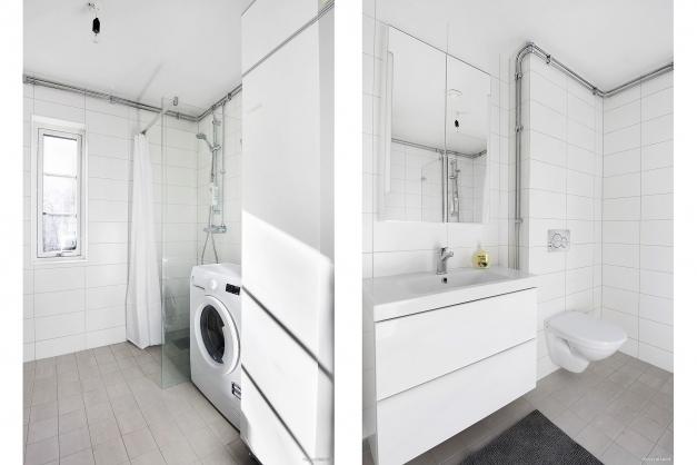 Badrum med duschhörna, tvättställ, wc och tvättmaskin samt värmepanna