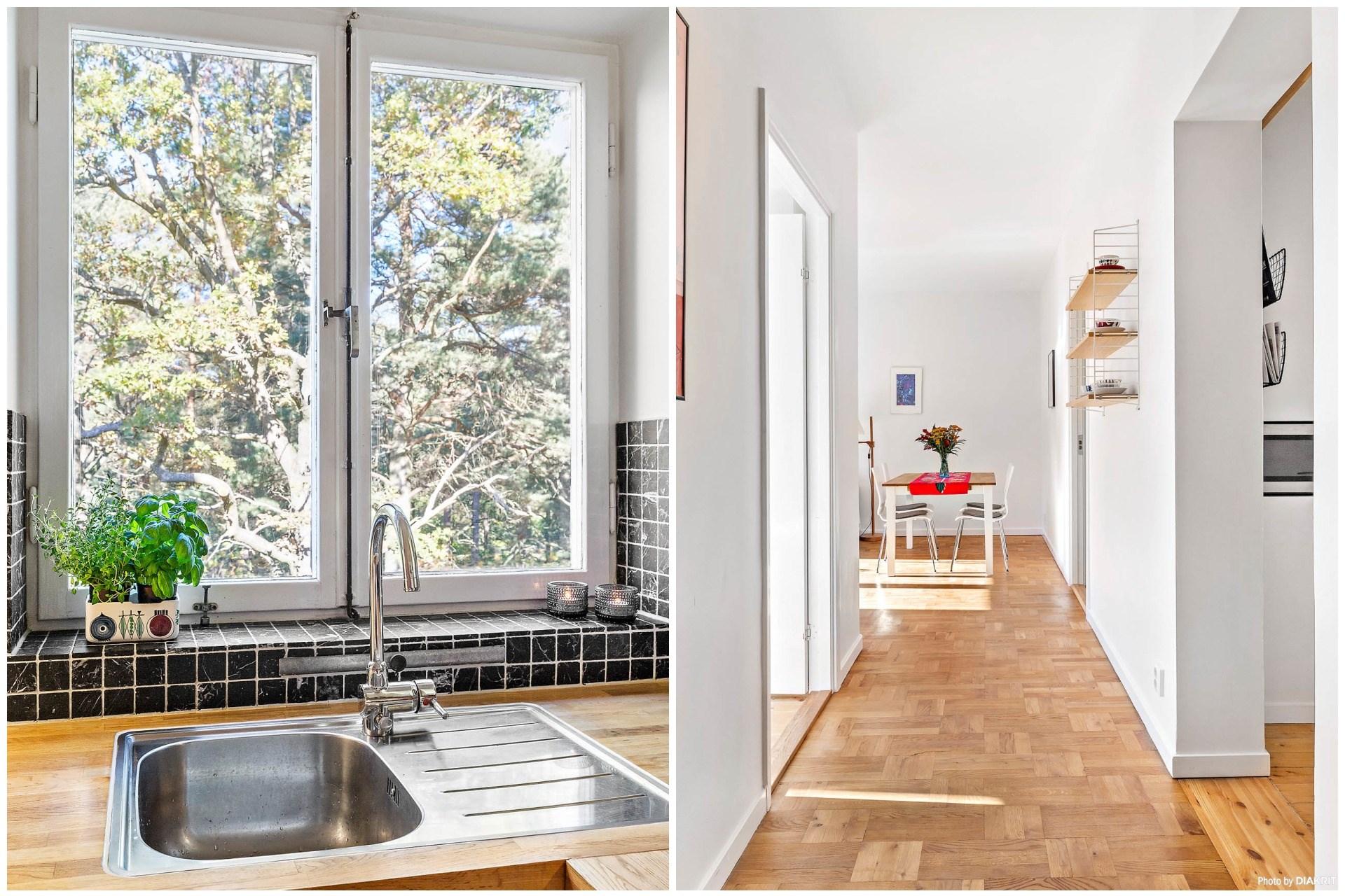Diskho i rostfritt invid fönster mot lummig baksida. Hall ut från kök mot vardagsrum.