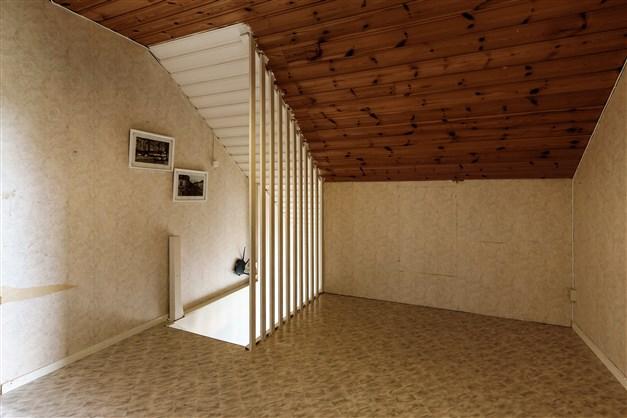 Allrummet som binder samma de två sovrummen på övre plan
