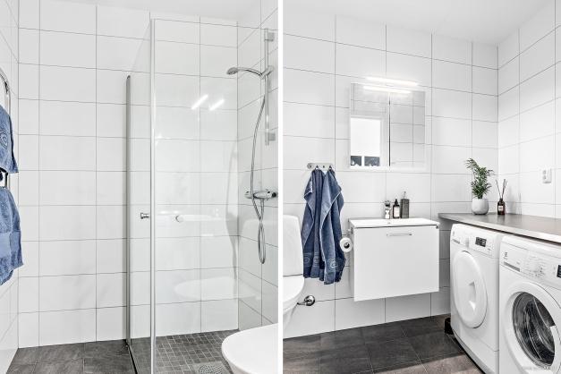 Helkaklat badrum med tvättmaskin och torktumlare och bra bänkyta.