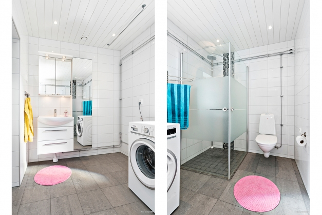 Helkaklat badrum med dusch och tvättmaskin