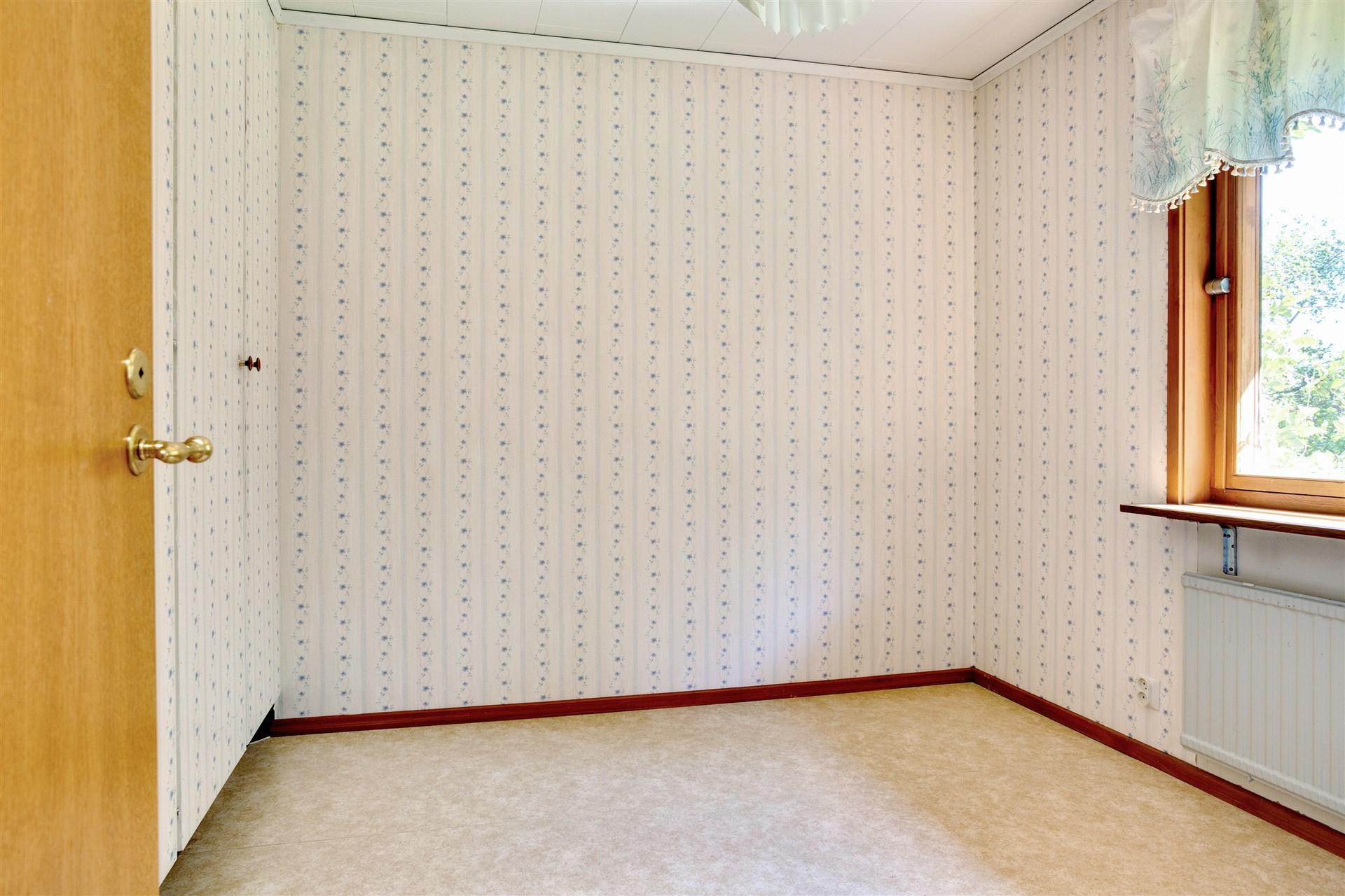 Sovrum 3 med flera garderober.