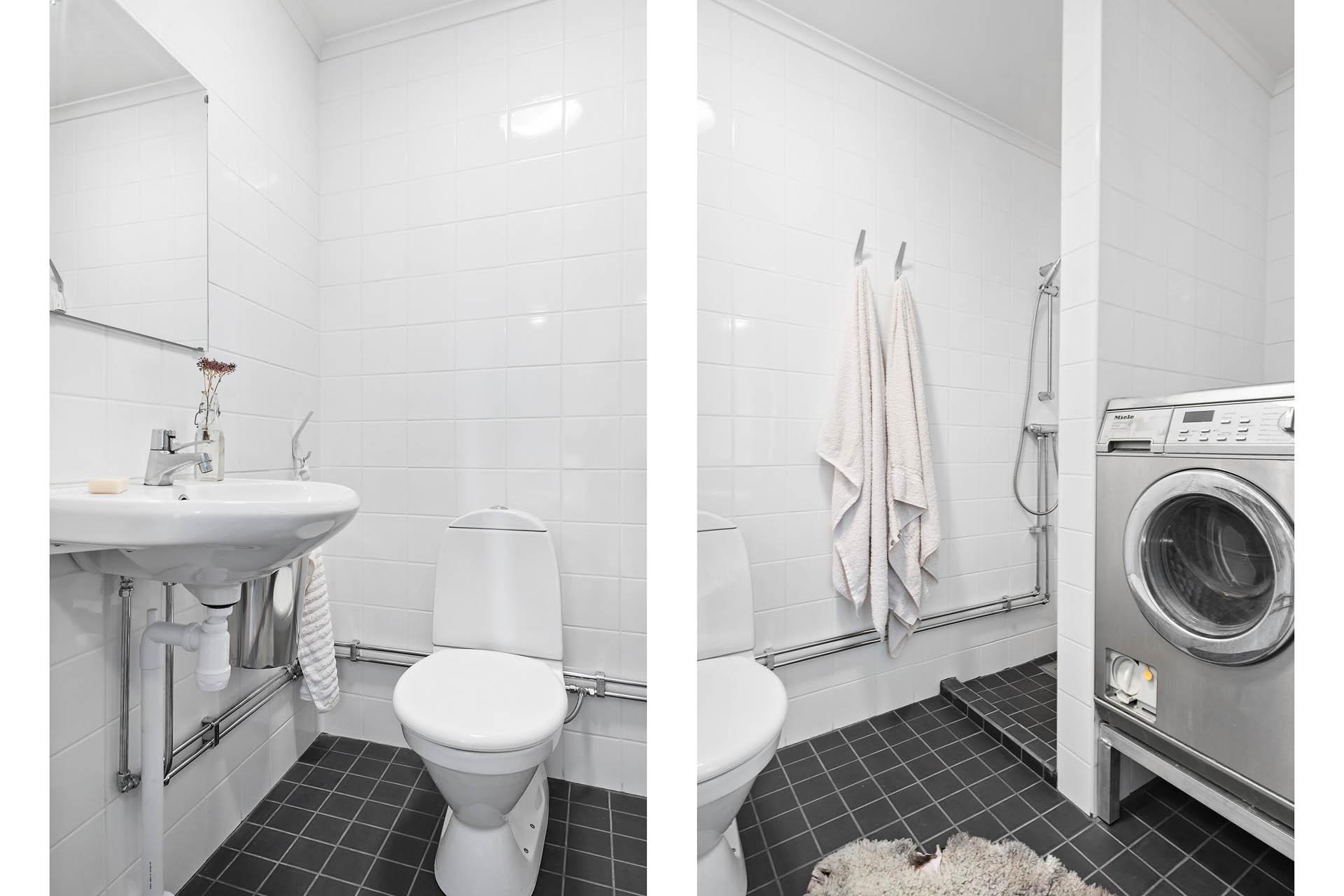 Duschrum med tvätt i gästlägenheten.