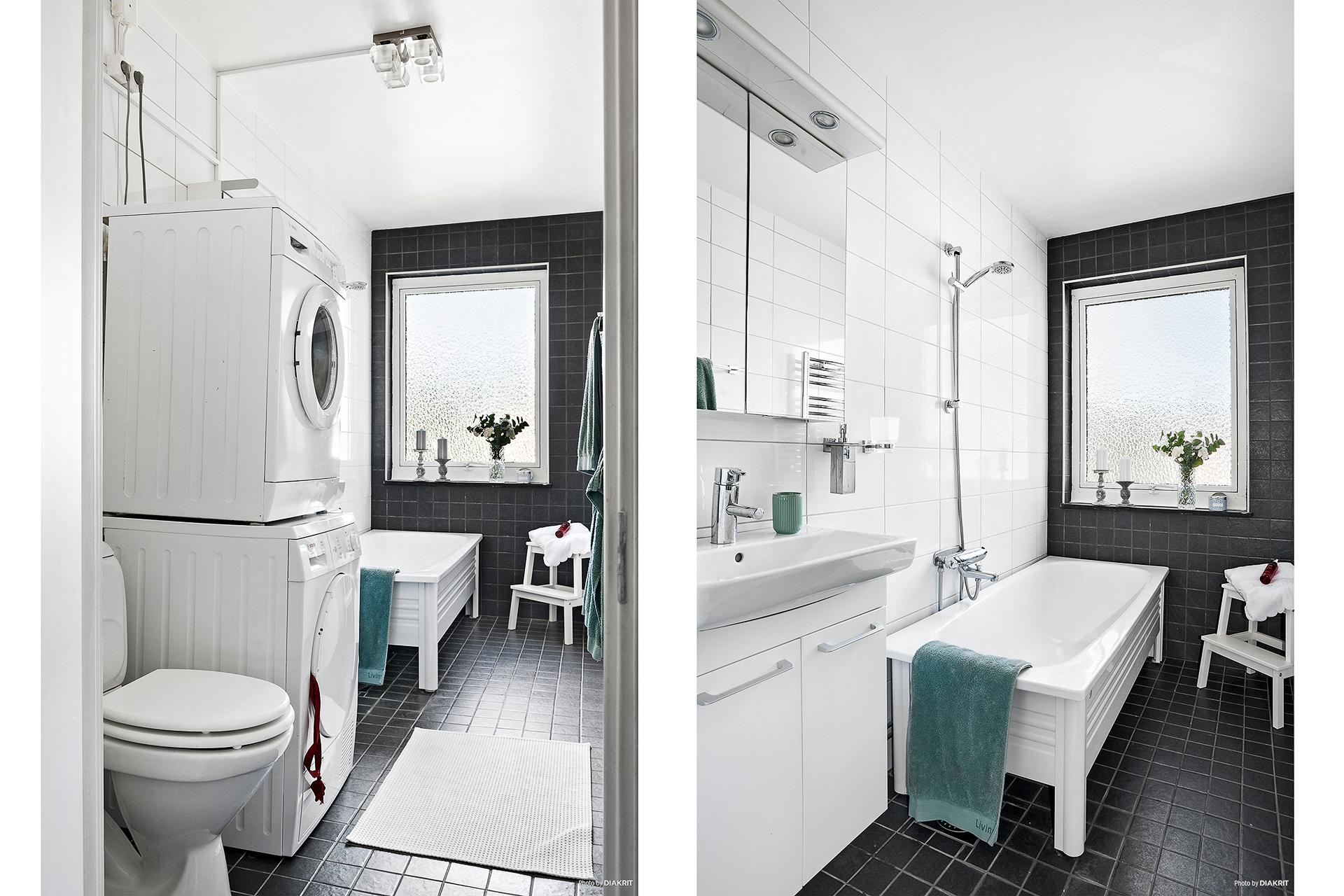 Helkaklat badrum med badkar, nyare badrumsmöbler, tvättmaskin och torktumlare.