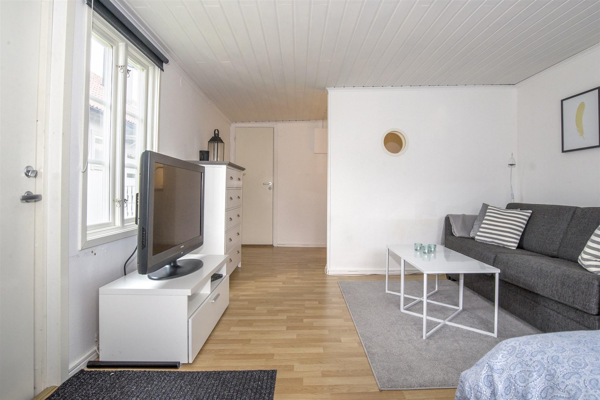 Vardagsrum/sovrum i gästhus