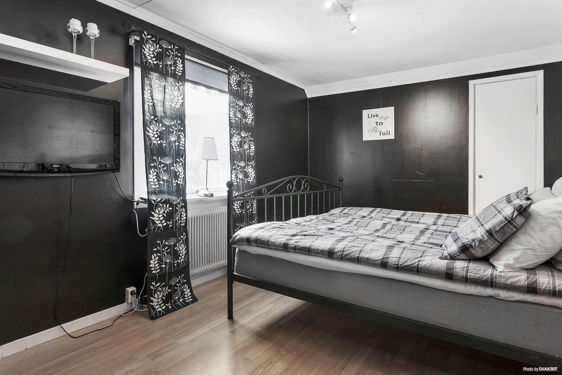 Det större sovrummet