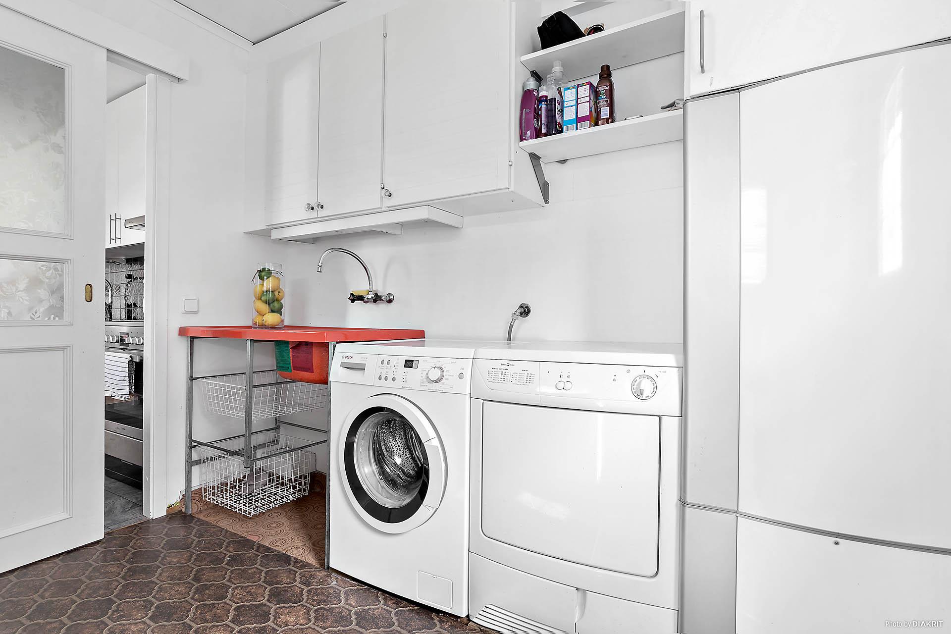 Tvättstuga intill kök
