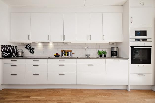 Modernt och ljust kök med vitvaror från Siemens