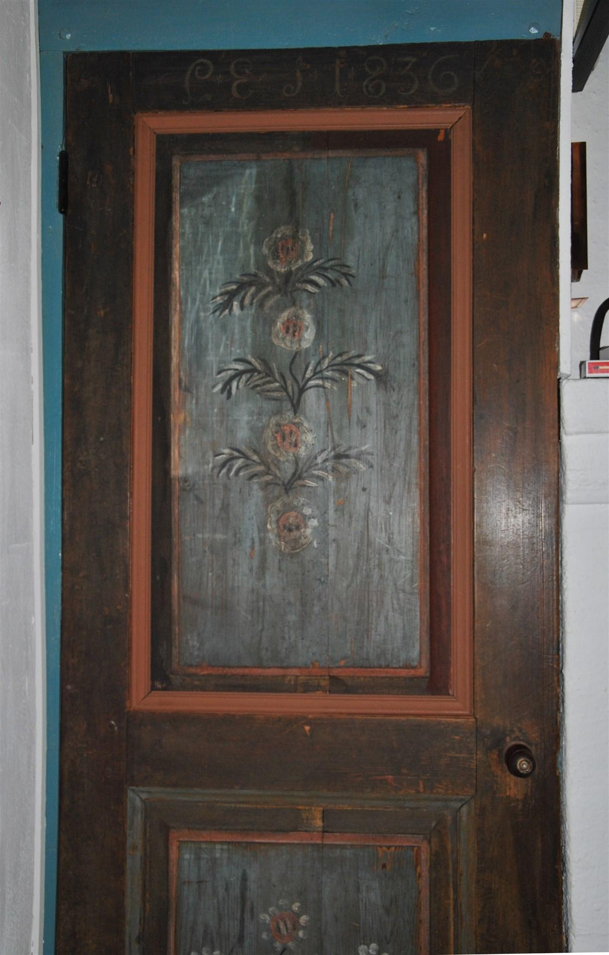 Målning på dörr till förvaringsutrymme, signerat 1836