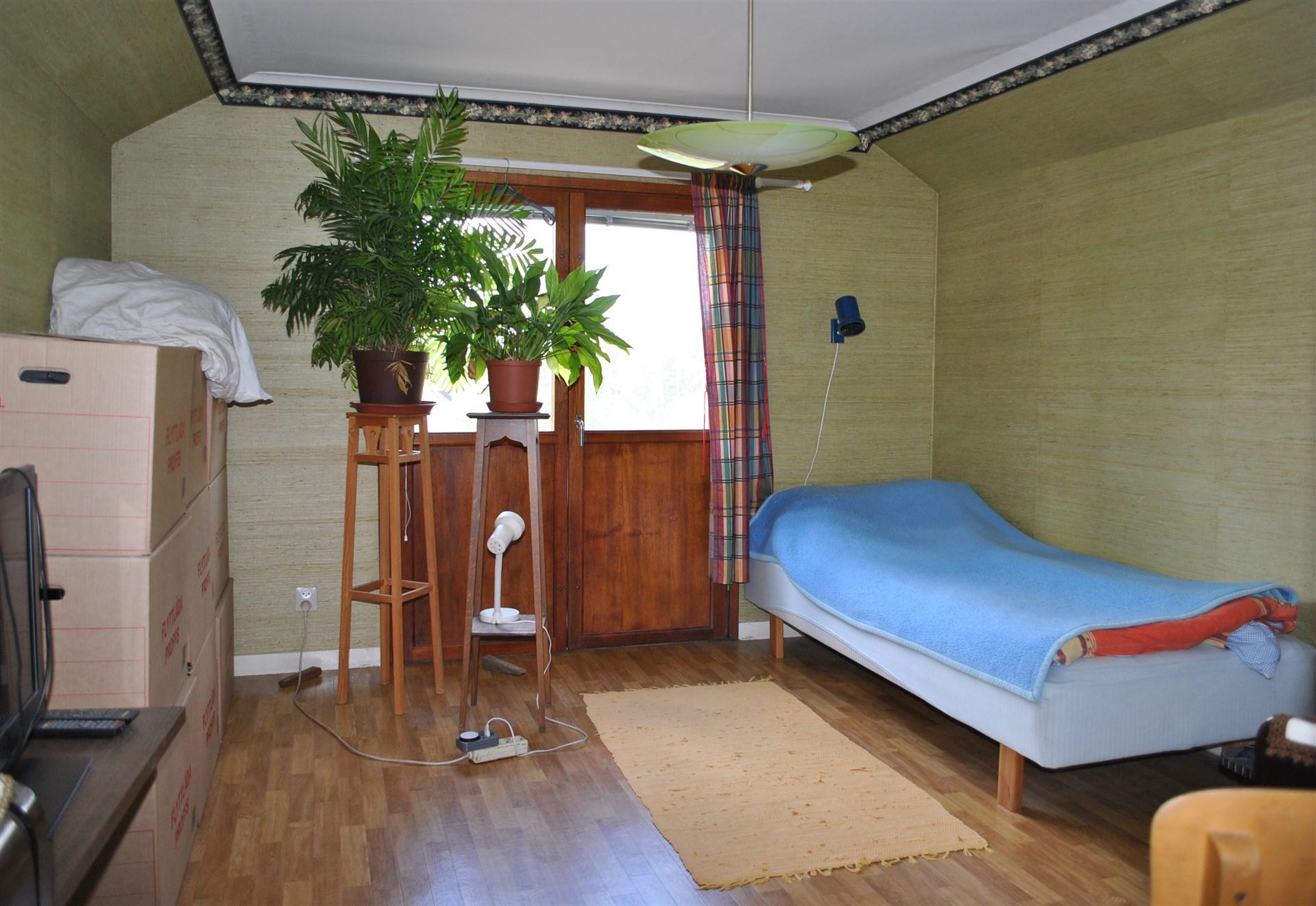 Ett av sovrummen på övervåningen