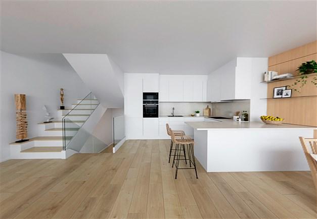 Illustrationsbild - Modernt kök med öppen planlösning mot vardagsrummet