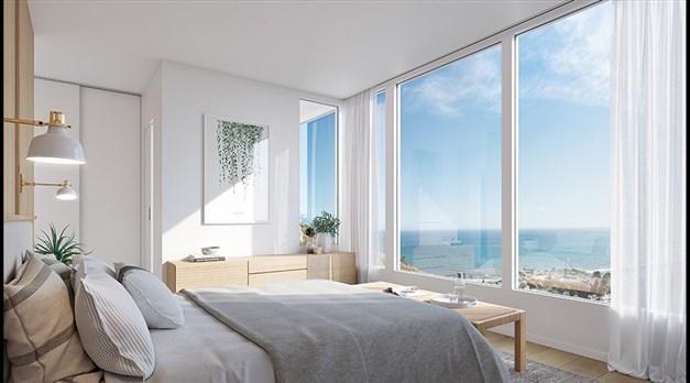 Illustrationsbild - Master bedroom med havsutsikt och eget badrum