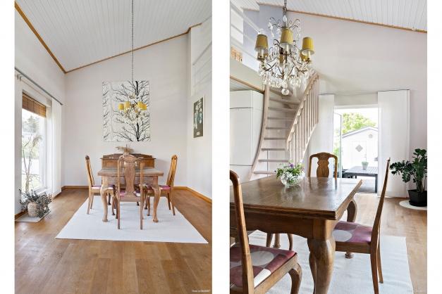 Matrum med trappa upp till loft och utgång till altan och trädgård