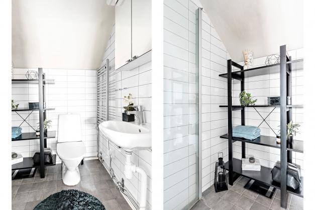 Helkaklat badrum med el-golvvärme, dusch, wc och handdukstork.