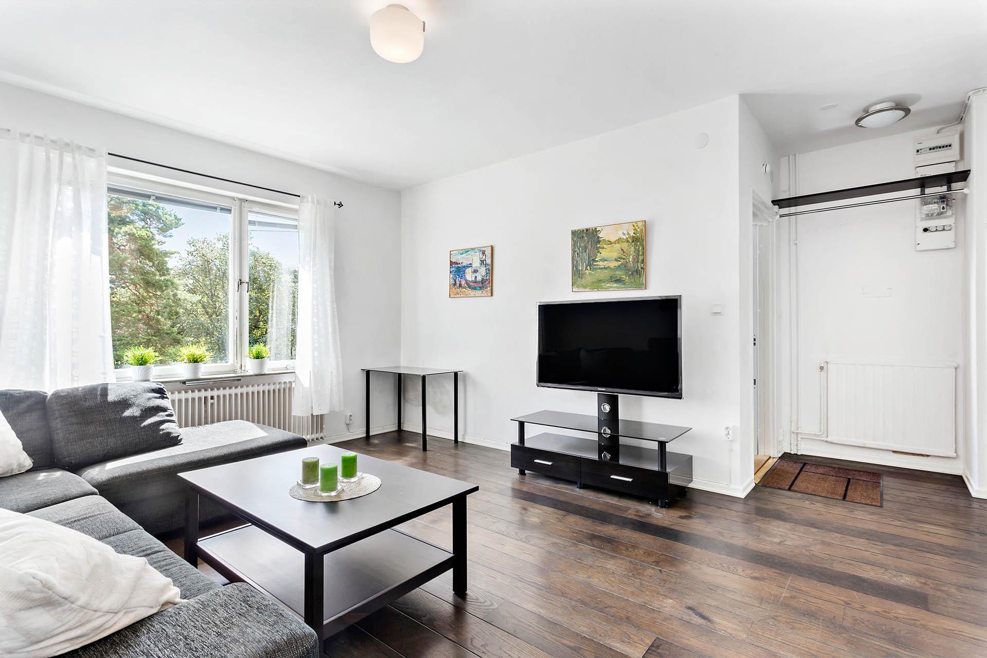 Vardagsrum med möbleringsalternativ.