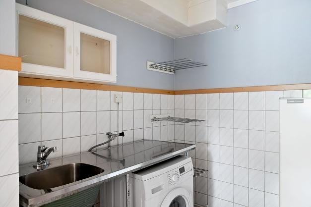 Tvättstugan innanför köket