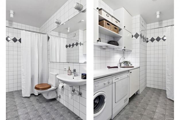 Helkaklat badrum med välorganiserad tvättavdelning.