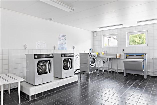 Gemensam tvättstuga.