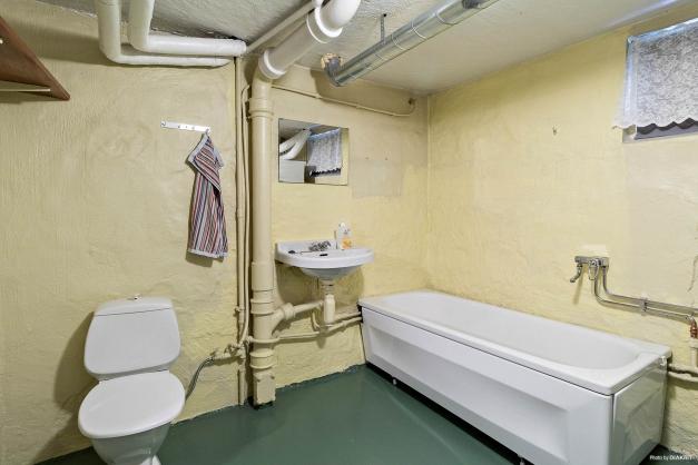 Tvättstuga med badrum.