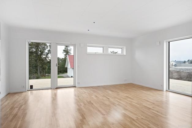 OBS! Fotografiet är från en färdigbyggd lägenhet. Avvikelser kan förekomma. Bl.a. varierar altandörren och altanens placering beroende på lägenhet.