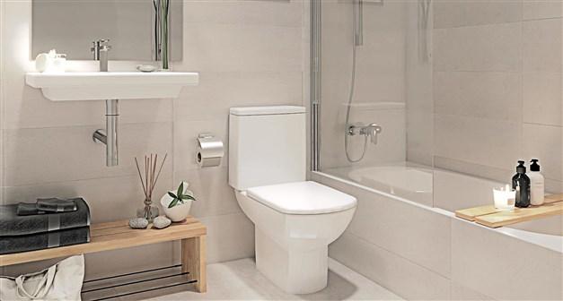 llustrationsbild - helkaklade badrum med badkar
