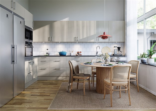 Köket i 1-planshusen. Bilden är en visualisering och skall ses som en inspirationsbild. Tillval på bilden är lucka Solid i Ostronbeige kulör samt rostfria vitvaror.