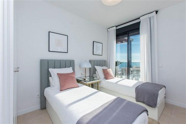 Illustrationsbild - sovrum med havsutsikt