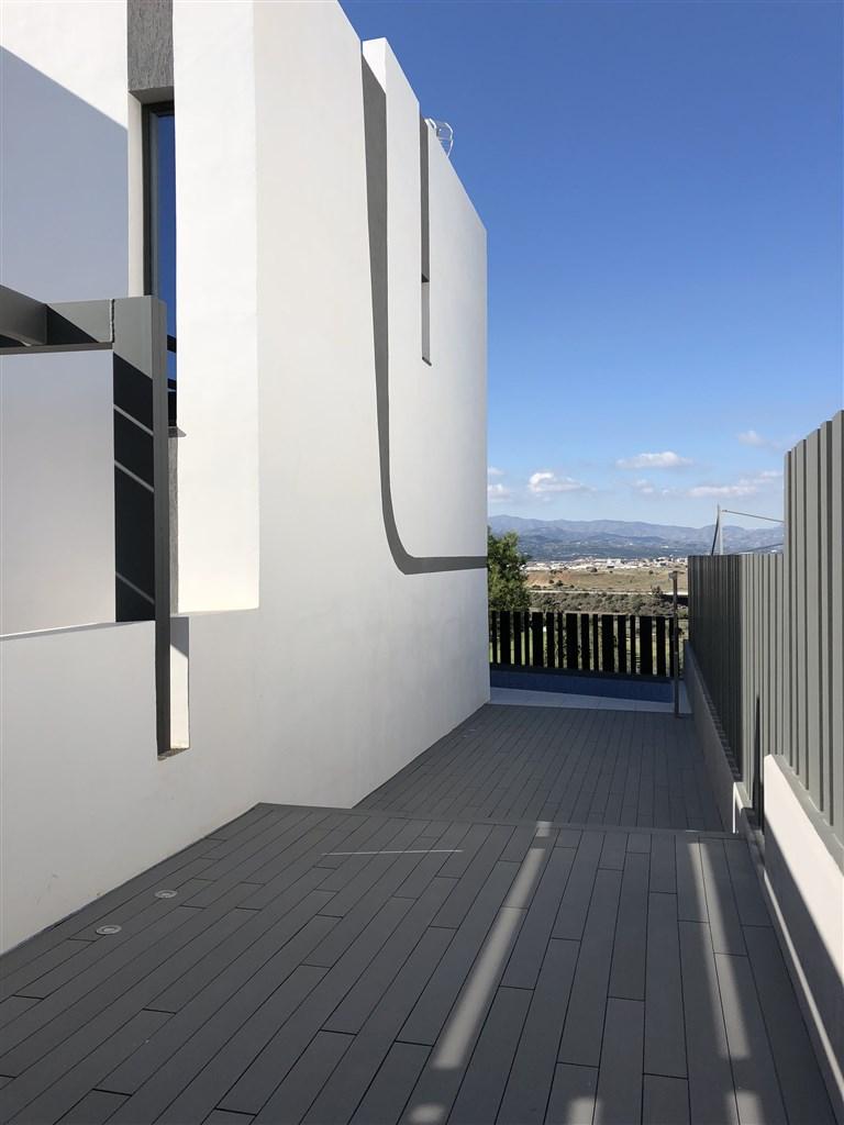 Fasadbild hörnradhus - byggföretagets foto