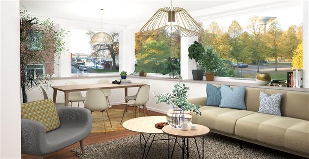 Panoramaglas omger större delan av vardagsrum/matplats med vy över slottsparken och hamninloppet i Nyhamn (lgh 4)